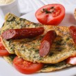 Stock Photo: Omelet with spinach, tomatoes and sausage close-up