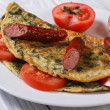 Stock Photo: Omelet with spinach, sausage and tomatoes. fed breakfast