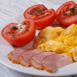 Stock Photo: Breakfast omelet with ham and tomatoes on table