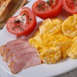 Stock Photo: Delicious breakfast. omelet with ham and tomatoes and croutons
