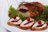 Chicken breast stuffed with cranberries with sauce — Stock Photo