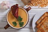 Pea soup with smoked meat and ingredients. top view — Stock Photo