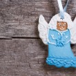 Ginger biscuits. Blue Christmas angel on a background of wooden boards — Stock Photo #36002083