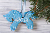 Gingerbread blue horse on the Christmas tree — Stock Photo