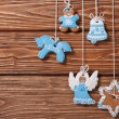 Christmas gingerbread hanging on the ropes — Stock Photo