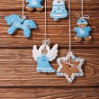 Christmas gingerbread hanging on the ropes. vertical — Stock Photo