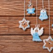 Christmas gingerbread cookies hanging on a wooden boards — Stock Photo