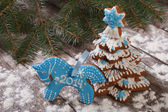Blue horse cookies and gingerbread Christmas tree — Stock Photo