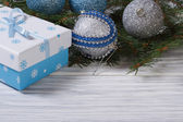 Christmas card with balls, gift box and spruce — Photo