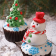 Stock Photo: Cupcake Christmas snowmon background of fir trees
