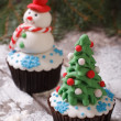 Cupcake Christmas tree on background with snowman — Stock Photo