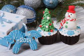 Christmas cake and symbol 2014 blue horse — Stock Photo