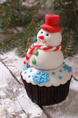 Cupcake Christmas snowman on snow. vertical — Stock Photo