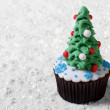 Cupcake Christmas tree on white snow. Merry Christmas — Stock Photo #36208253