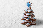 Christmas tree made of cookies on the white snow — Stock Photo