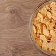 Dry corn flakes in a glass bowl on the table. View from above. — Stock Photo #36618859