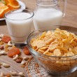 Corn flakes with dried fruit and milk — Stock Photo #36620455