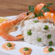Risotto with seafood on wooden table  — Stock Photo