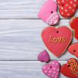 Many different hearts valentines biscuits on a beautiful wooden — Stock Photo
