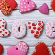 Gingerbread in the form of hearts and letters on a wooden — Stock Photo