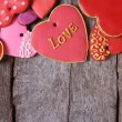 Many different hearts valentines cookies on old wooden table — Stock Photo