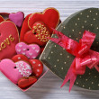 Colorful hearts biscuits in festive box top view — Stock Photo #37420981