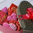 Colorful hearts biscuits in festive box with a bow — Stock Photo #37421067