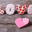Postcard Valentine's Day. The word love and heart of cookies on — Stock Photo