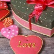 Beautiful box of heart and a lot of colorful holiday cookies — Stock Photo
