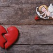 Frame for Valentine's Day. Biscuits Cupid and a broken heart — Stock Photo #37423971