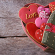 Open gift box with cookies valentines on the old wooden table — Stock Photo