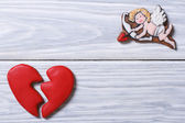 Cupid and a broken heart. Frame of cookies on Valentine's Day — Stock Photo