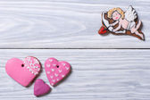 Cupid and pink hearts. Frame of cookies on Valentine's Day — Stock Photo