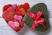 Colorful hearts biscuits in festive box top view — Stock Photo