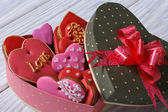 Colorful hearts biscuits in festive box with a bow — Stock Photo
