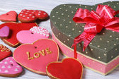 Festive box with a bow and colorful biscuit hearts for Valentine — Stock Photo