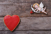 Frame for Valentine's Day. Cupid shoots arrows at hearts — Stock Photo
