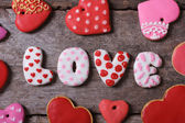 Love and heart. Beautiful cakes on a wooden table — Stock Photo