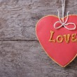 Red sweet cookies heart on background of the old board. — Stock Photo