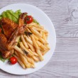Two fried chicken wings, french fries. top view — Stock Photo #38301563