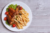 Two fried chicken wings, french fries. top view — Stock Photo