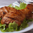 Roasted chicken legs with salad and a slice of lemon — Stock Photo #38423115