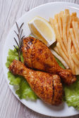 Chicken drumsticks with french fries. view from above closeup — Stock Photo