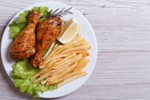 Two fried chicken drumsticks with french fries. top view — Stock Photo