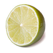 Half of fresh lime isolated on a white background — Stock Photo