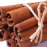 Bundle of cinnamon sticks closeup isolated on white background — Stock Photo #38771735