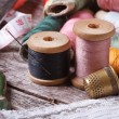 Tools for sewing: thread, scissors, tape, needle, thimble — Stock Photo #38905375