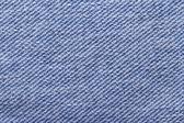 Closeup of blue jeans fabric texture — Stock Photo