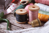 Tools for sewing: thread, scissors, tape, needle, thimble — Stock Photo