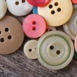 Stock Photo: Lots of colorful buttons close up
